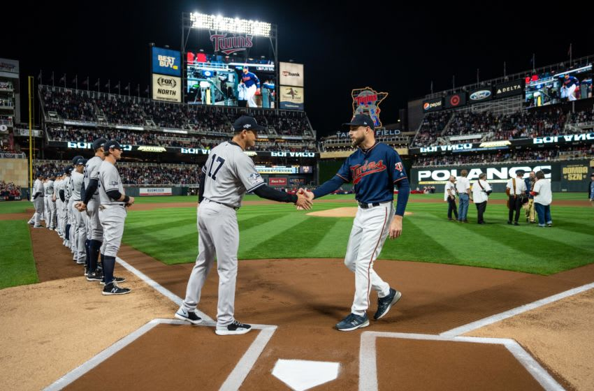MINNEAPOLIS, MN - OCTOBER 07: Managers Rocco Baldelli #5 of the Minnesota Twins and Aaron Boone #17 of the New York Yankees meet prior to the game on October 7, 2019 in game three of the American League Division Series at the Target Field in Minneapolis, Minnesota. (Photo by Brace Hemmelgarn/Minnesota Twins/Getty Images)