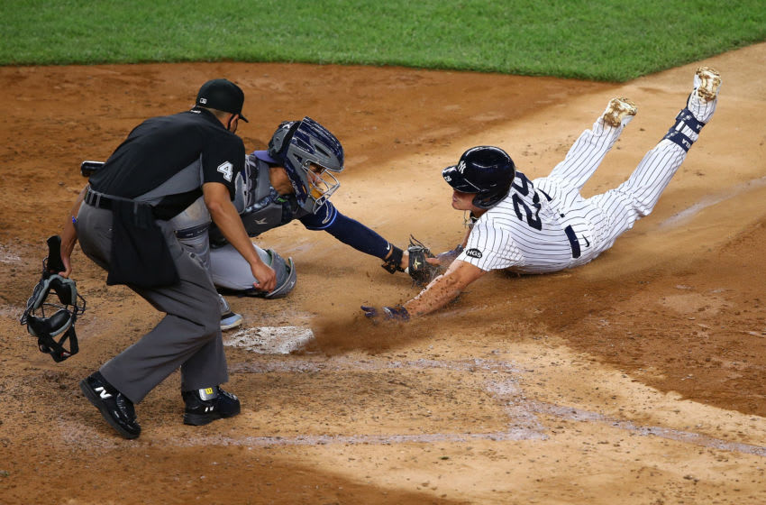 Gio Urshela #29 of the New York Yankees scores after hitting a triple on a throwing error by Willy Adames #1 of the Tampa Bay Rays in the sixth inning at Yankee Stadium on September 01, 2020 in New York City. (Photo by Mike Stobe/Getty Images)