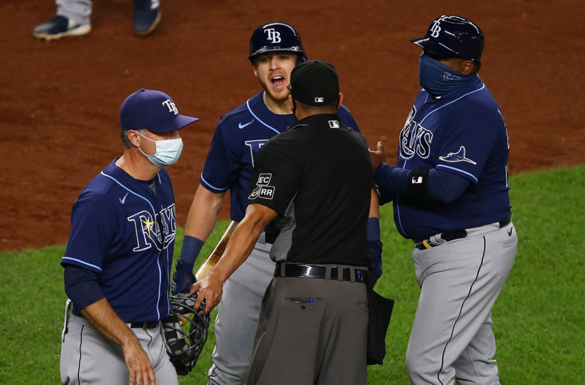 NEW YORK, NEW YORK - SEPTEMBER 01: Michael Brosseau #43 of the Tampa Bay Rays exchanges words with New York Yankees after the final out in the ninth inning at Yankee Stadium on September 01, 2020 in New York City. (Photo by Mike Stobe/Getty Images)