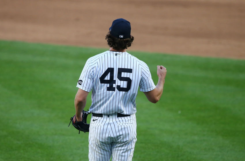 NEW YORK, NEW YORK - SEPTEMBER 11: Gerrit Cole #45 of the New York Yankees celebrates after defeating the Baltimore Orioles 6-0 at Yankee Stadium on September 11, 2020 in New York City. (Photo by Mike Stobe/Getty Images)