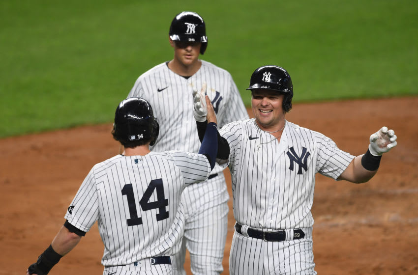 Luke Voit #59 of the New York Yankees celebrates with Tyler Wade #14 after hitting a three-run home run during the second inning against the Toronto Blue Jays at Yankee Stadium on September 15, 2020 in the Bronx borough of New York City. (Photo by Sarah Stier/Getty Images)