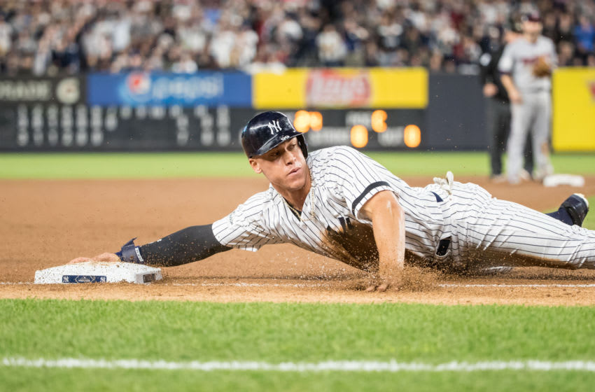 Aaron Judge #99 of the New York Yankees slides against the Minnesota Twins during the American League Wild Card Game at Yankee Stadium on October 3, 2017 in the Bronx borough of New York City. (Photo by Brace Hemmelgarn/Minnesota Twins/Getty Images)*** Local Caption *** Aaron Judge