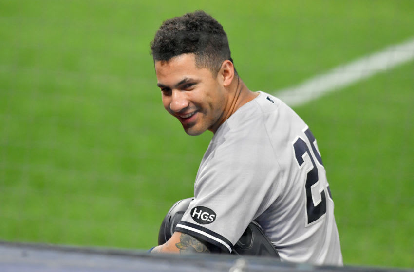 CLEVELAND, OHIO - SEPTEMBER 29: Gleyber Torres #25 of the New York Yankees jokes with his teammates in the dugout during a pitching change during the eighth inning of Game One of the American League Wild Card Series against the Cleveland Indians at Progressive Field on September 29, 2020 in Cleveland, Ohio. The Yankees defeated the Indians 12-3. (Photo by Jason Miller/Getty Images)