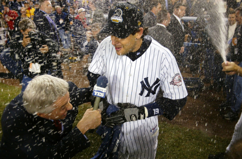 BRONX, NY - OCTOBER 16: Aaron Boone #19 of the New York Yankees is showered with champagne after hitting the game winning home run in the bottom of the eleventh inning against the Boston Red Sox during game 7 of the American League Championship Series on October 16, 2003 at Yankee Stadium in the Bronx, New York. The Yankees won 6-5, advancing them to the World Series. (Photo by Ezra Shaw/Getty Images)