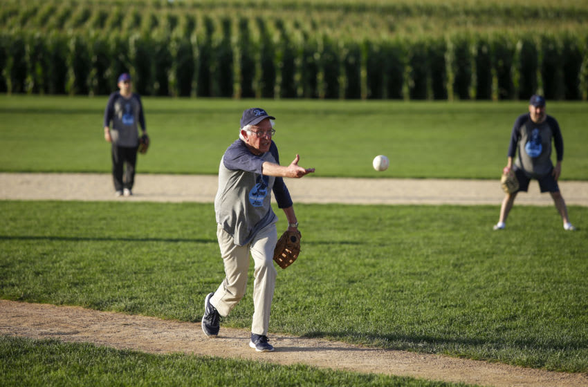 DYERSVILLE, IA - AUGUST 19: Democratic presidential candidate Sen. Bernie Sanders (I-VT) pitches against the Leaders Believers Achievers Foundation team during a baseball game at the Field of Dreams Baseball field on August 19, 2019 in Dyersville, Iowa. Sanders is one of over 20 candidates running for president on the Democratic ticket against Republican President Donald Trump. (Photo by Joshua Lott/Getty Images)