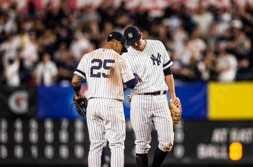NEW YORK - MAY 31: Gleyber Torres #25 and DJ LeMahieu #26 of the New York Yankees high five after the game against the Boston Red Sox at Yankee Stadium on May 31, 2019 in the Bronx borough of New York City. (Photo by Rob Tringali/SportsChrome/Getty Images)