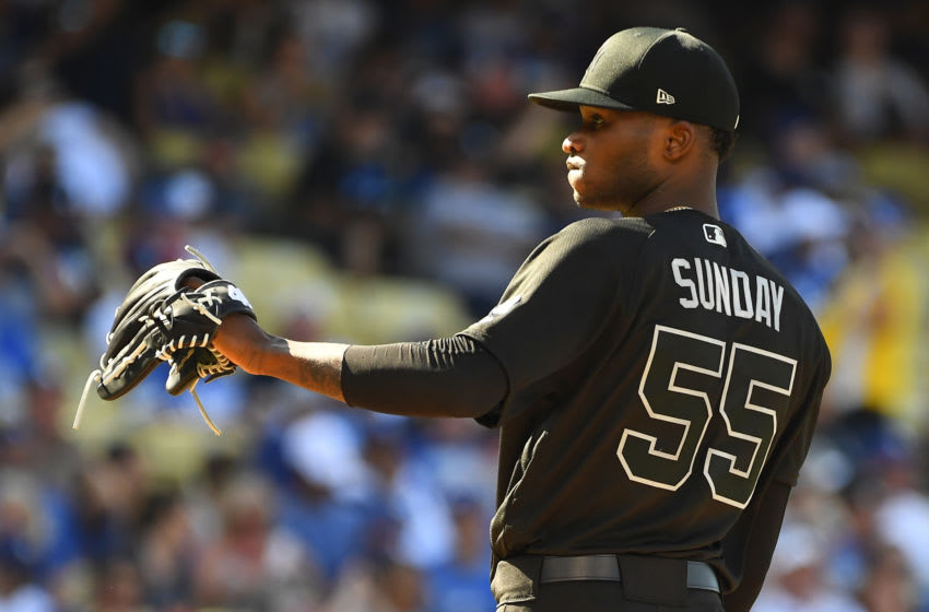 LOS ANGELES, CA - AUGUST 25: Starting pitcher Domingo German #55 of the New York Yankees takes the mound during the game against the Los Angeles Dodgers at Dodger Stadium on August 25, 2019 in Los Angeles, California. Teams are wearing special color schemed uniforms with players choosing nicknames to display for Players' Weekend. (Photo by Jayne Kamin-Oncea/Getty Images)