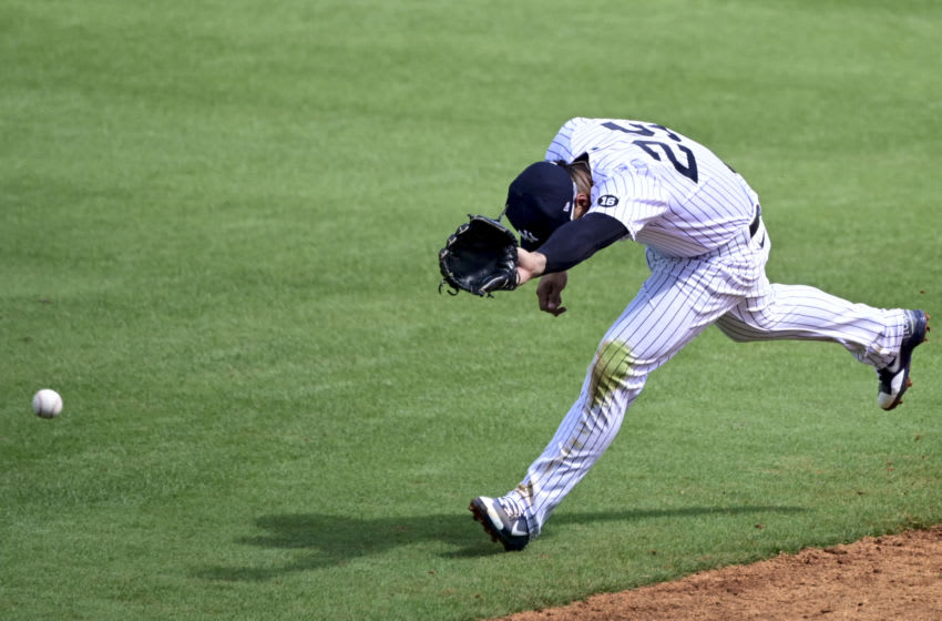 TAMPA, FLORIDA - FEBRUARY 28: Gleyber Torres #25 of the New York Yankees attempts to field a line drive during the third inning against the Toronto Blue Jays during a spring training game at George M. Steinbrenner Field on February 28, 2021 in Tampa, Florida. (Photo by Douglas P. DeFelice/Getty Images)