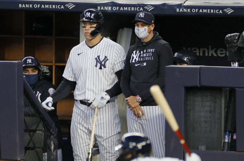 NEW YORK, NEW YORK - APRIL 06: Manager Aaron Boone #17 of the New York Yankees and Aaron Judge #99 watch from the dugout during the second inning against the Baltimore Orioles at Yankee Stadium on April 06, 2021 in the Bronx borough of New York City. (Photo by Sarah Stier/Getty Images)