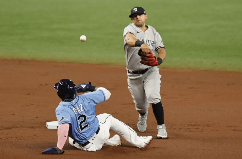 ST PETERSBURG, FLORIDA - APRIL 11: Rougned Odor #18 of the New York Yankees forces out Yandy Díaz #2 of the Tampa Bay Rays and turns for a double play during the first inning at Tropicana Field on April 11, 2021 in St Petersburg, Florida. (Photo by Douglas P. DeFelice/Getty Images)