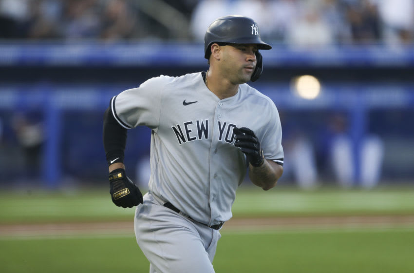 BUFFALO, NEW YORK - JUNE 15: Gary Sanchez #24 of the New York Yankees rounds the bases after hitting a home run during the second inning against the Toronto Blue Jays at Sahlen Field on June 15, 2021 in Buffalo, New York. (Photo by Joshua Bessex/Getty Images)