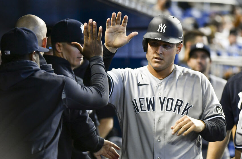 MIAMI, FL - JULY 31: Anthony Rizzo #48 of the New York Yankees is congratulated by teammates after scoring in the second inning against the Miami Marlins at loanDepot park on July 31, 2021 in Miami, Florida. (Photo by Eric Espada/Getty Images)