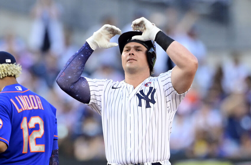 NEW YORK, NEW YORK - JULY 04: Luke Voit #59 of the New York Yankees celebrates after hitting a double against the New York Mets in the second inning during game two of a doubleheader at Yankee Stadium on July 04, 2021 in the Bronx borough of New York City. (Photo by Steven Ryan/Getty Images)