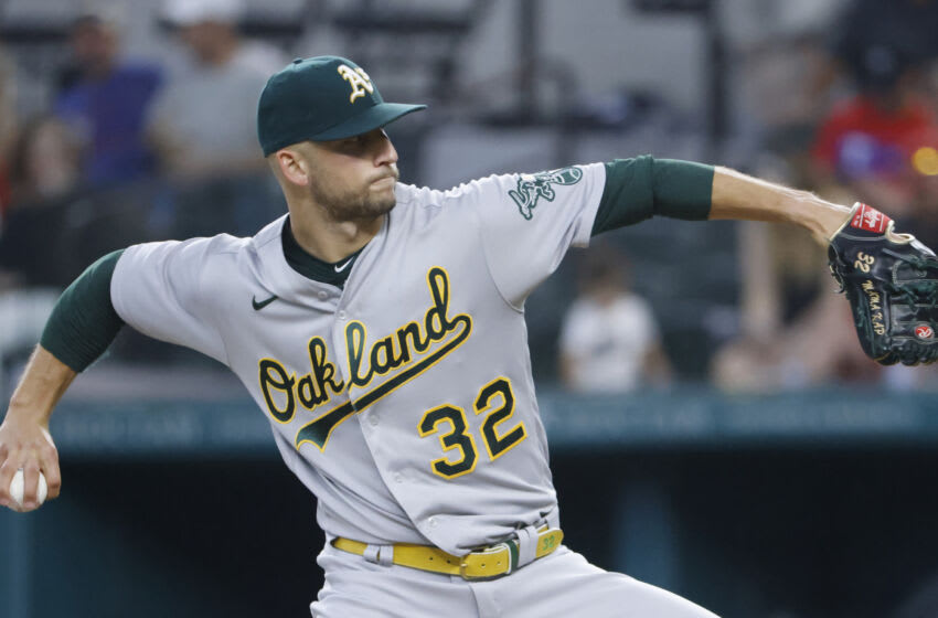 ARLINGTON, TX - JULY 10: James Kaprielian #32 of the Oakland Athletics pitches against the Texas Rangers during the first inning at Globe Life Field on July 10, 2021 in Arlington, Texas. (Photo by Ron Jenkins/Getty Images)