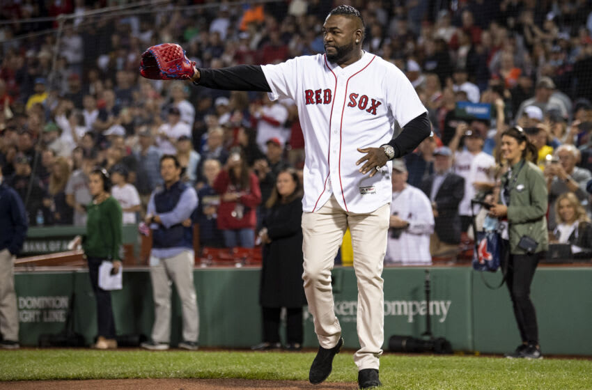 BOSTON, MA - SEPTEMBER 26: Former Boston Red Sox designated hitter David Ortiz is introduced before catching a ceremonial first pitch from the family of fallen Sergeant Johanny Rosario Pichardo before a game between the Boston Red Sox and the New York Yankees on September 26, 2021 at Fenway Park in Boston, Massachusetts. (Photo by Billie Weiss/Boston Red Sox/Getty Images)