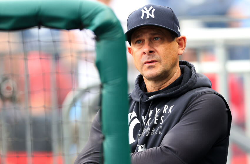PHILADELPHIA, PA - JUNE 12: Manager Aaron Boone #17 of the New York Yankees in the dugout during a game against the Philadelphia Phillies at Citizens Bank Park on June 12, 2021 in Philadelphia, Pennsylvania. (Photo by Rich Schultz/Getty Images)