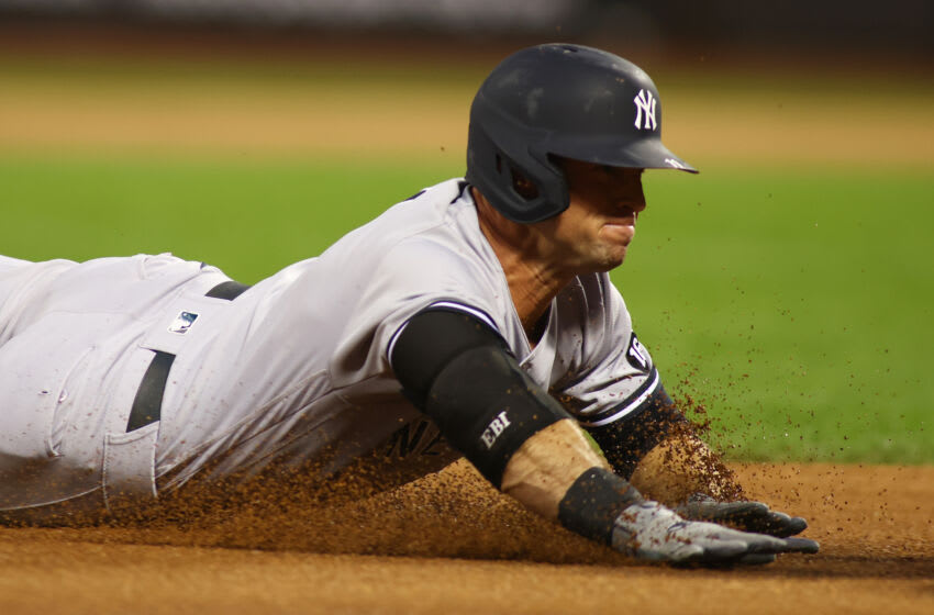 NEW YORK, NEW YORK - SEPTEMBER 10: Brett Gardner #11 of the New York Yankees slides into third base after hitting a first inning triple against the against the New York Mets at Citi Field on September 10, 2021 in New York City. (Photo by Mike Stobe/Getty Images)