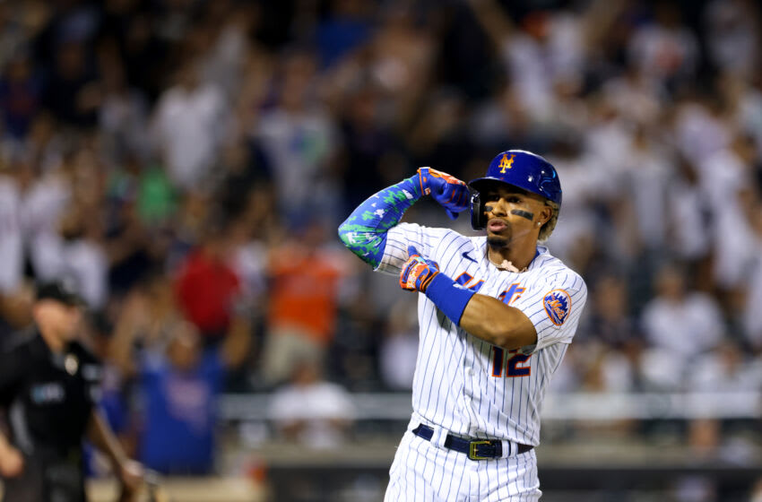 NEW YORK, NY - SEPTEMBER 12: Francisco Lindor #12 of the New York Mets gestures after he hits a home run against the New York Yankees during the eighth inning of a game at Citi Field on September 12, 2021 in New York City. The Mets defeated the Yankees 7-6 as Lindor hit three home runs. (Photo by Rich Schultz/Getty Images)