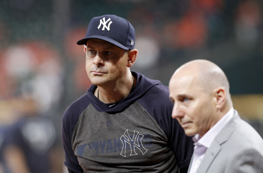 HOUSTON, TX - OCTOBER 13: Manager Aaron Boone #17 of the New York Yankees watches batting practice before game two of the American League Championship Series against the Houston Astros at Minute Maid Park on October 13, 2019 in Houston, Texas. (Photo by Tim Warner/Getty Images)
