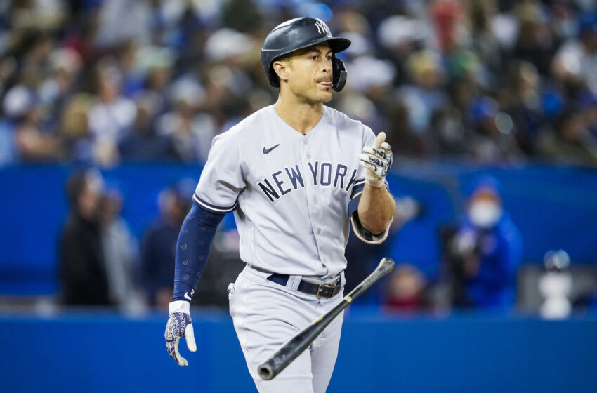 TORONTO, ONTARIO - SEPTEMBER 28: Giancarlo Stanton #27 of the New York Yankees flips the bat after hitting a three run home run against the Toronto Blue Jays in the seventh inning during their MLB game at the Rogers Centre on September 28, 2021 in Toronto, Ontario, Canada. (Photo by Mark Blinch/Getty Images)