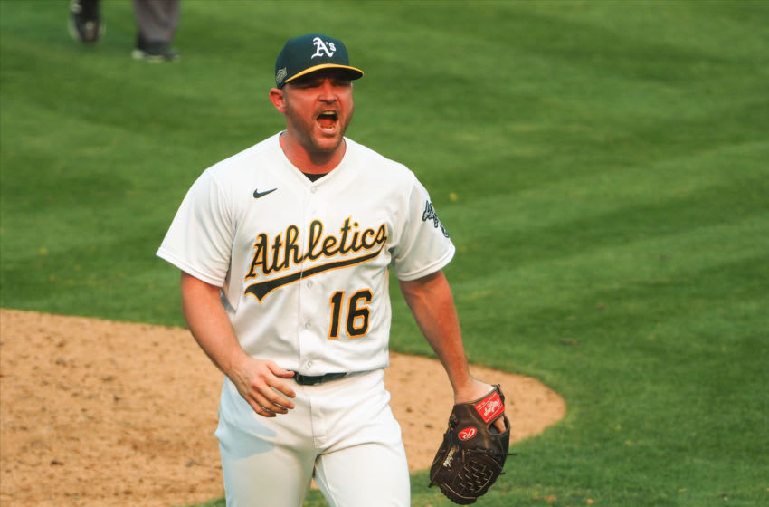 Oct 1, 2020; Oakland, California, USA; Oakland Athletics relief pitcher Liam Hendricks (16) celebrates after the win against the Chicago White Sox at Oakland Coliseum. Mandatory Credit: Kelley L Cox-USA TODAY Sports