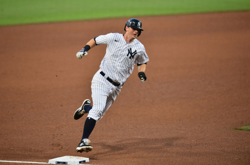 Oct 7, 2020; San Diego, California, USA; New York Yankees second baseman DJ LeMahieu (26) runs home to score on a double by center fielder Aaron Hicks (not pictured) against the Tampa Bay Rays in the fifth inning during game three of the 2020 ALDS at Petco Park. Mandatory Credit: Gary A. Vasquez-USA TODAY Sports