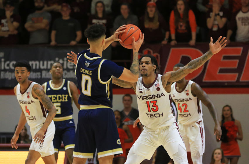 BLACKSBURG, VA - FEBRUARY 13: Ahmed Hill #13 of the Virginia Tech Hokies guards against Michael Devoe #0 of the Georgia Tech Yellow Jackets in the second half at Cassell Coliseum on February 13, 2019 in Blacksburg, Virginia. (Photo by Lauren Rakes/Getty Images)