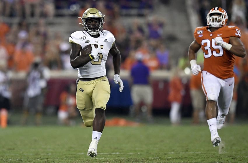 CLEMSON, SOUTH CAROLINA - AUGUST 29: Running back Jerry Howard Jr. #5 of the Georgia Tech Yellow Jackets makes a 54-yard reception as defensive end Justin Foster #35 of the Clemson Tigers pursues during the third quarter of their football game at Memorial Stadium on August 29, 2019 in Clemson, South Carolina. (Photo by Mike Comer/Getty Images)
