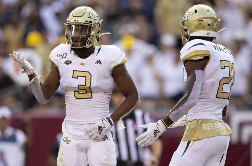 PHILADELPHIA, PA - SEPTEMBER 28: Tre Swilling #3 and Zamari Walton #21 of the Georgia Tech Yellow Jackets react after being called for a penalty in the second quarter against the Temple Owls at Lincoln Financial Field on September 28, 2019 in Philadelphia, Pennsylvania. (Photo by Mitchell Leff/Getty Images)