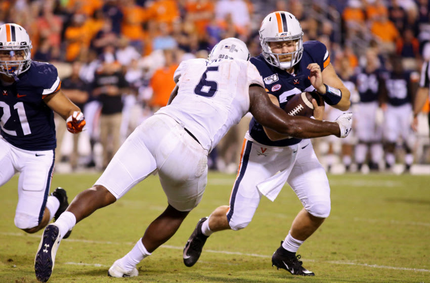 CHARLOTTESVILLE, VA - SEPTEMBER 21: Keion White #6 of the Old Dominion Monarchs sacks Lindell Stone #36 of the Virginia Cavaliers in the second half during a game at Scott Stadium on September 21, 2019 in Charlottesville, Virginia. (Photo by Ryan M. Kelly/Getty Images)