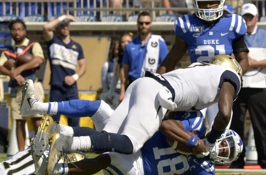 DURHAM, NORTH CAROLINA - OCTOBER 12: Demetrius Knight II #17 of the Georgia Tech Yellow Jackets tackles Quentin Harris #18 of the Duke Blue Devils during the first half of their game at Wallace Wade Stadium on October 12, 2019 in Durham, North Carolina. (Photo by Grant Halverson/Getty Images)