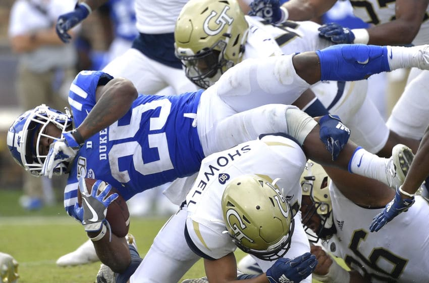 DURHAM, NORTH CAROLINA - OCTOBER 12: Avery Showell #13 of the Georgia Tech Yellow Jackets upends Deon Jackson #25 of the Duke Blue Devils during the second half of their game at Wallace Wade Stadium on October 12, 2019 in Durham, North Carolina. Duke won 41-23. (Photo by Grant Halverson/Getty Images)