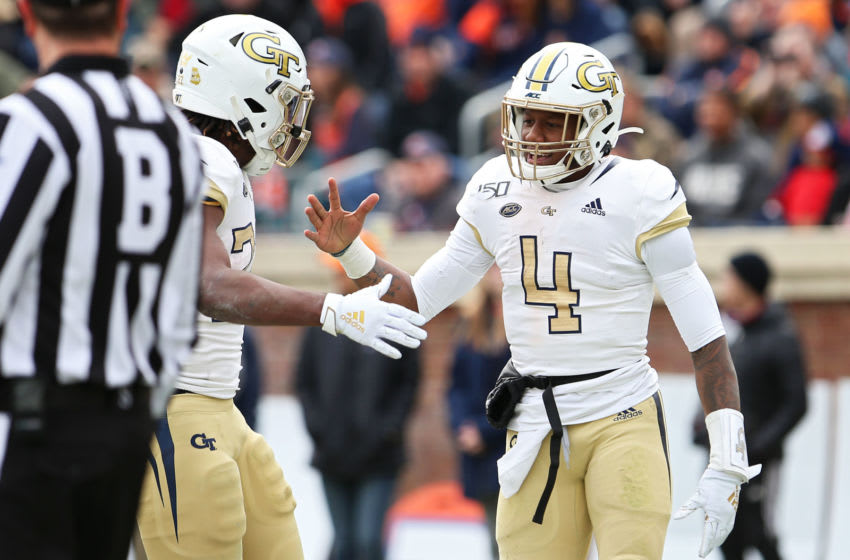 CHARLOTTESVILLE, VA - NOVEMBER 09: James Graham #4 and Jordan Mason #27 of the Georgia Tech Yellow Jackets celebrate a touchdown in the first half during a game against the Virginia Cavaliers at Scott Stadium on November 9, 2019 in Charlottesville, Virginia. (Photo by Ryan M. Kelly/Getty Images)