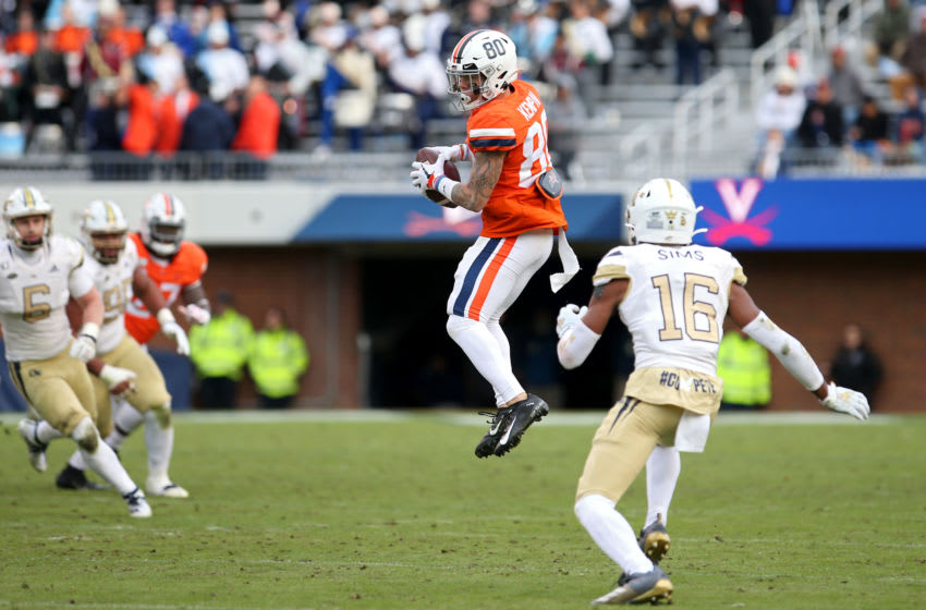 CHARLOTTESVILLE, VA - NOVEMBER 09: Billy Kemp IV #80 of the Virginia Cavaliers catches a pass over Myles Sims #16 of the Georgia Tech Yellow Jackets for a first down to seal the win in the second half during a game at Scott Stadium on November 9, 2019 in Charlottesville, Virginia. (Photo by Ryan M. Kelly/Getty Images)