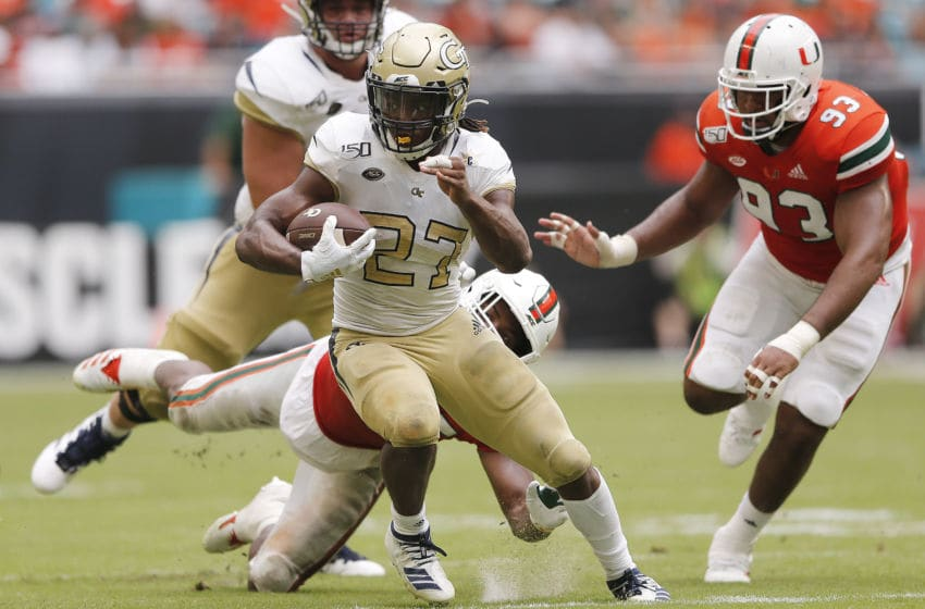 MIAMI, FLORIDA - OCTOBER 19: Jordan Mason #27 of the Georgia Tech Yellow Jackets runs with the ball against the Miami Hurricanes during the second half at Hard Rock Stadium on October 19, 2019 in Miami, Florida. (Photo by Michael Reaves/Getty Images)