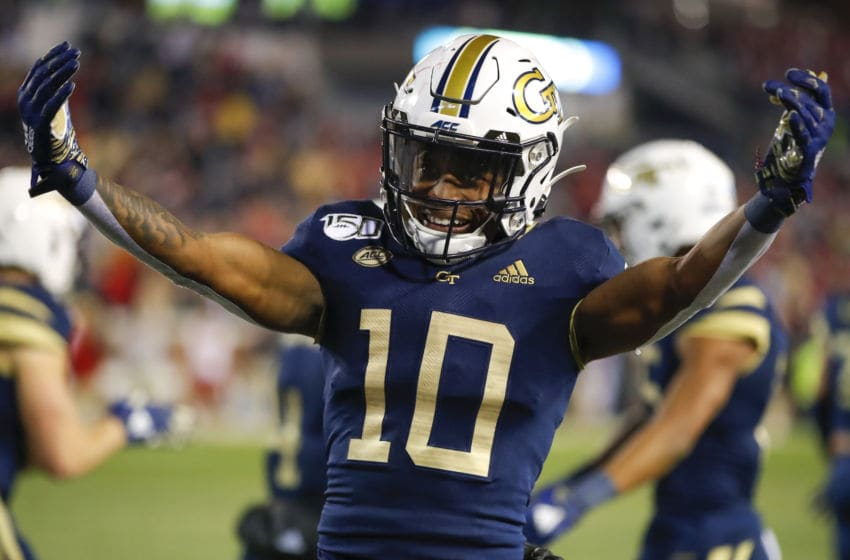 ATLANTA, GA - NOVEMBER 21: Ahmarean Brown #10 of the Georgia Tech Yellow Jackets reacts after a GT touchdown during the second half against the North Carolina State Wolfpack at Bobby Dodd Stadium on November 21, 2019 in Atlanta, Georgia. (Photo by Todd Kirkland/Getty Images)