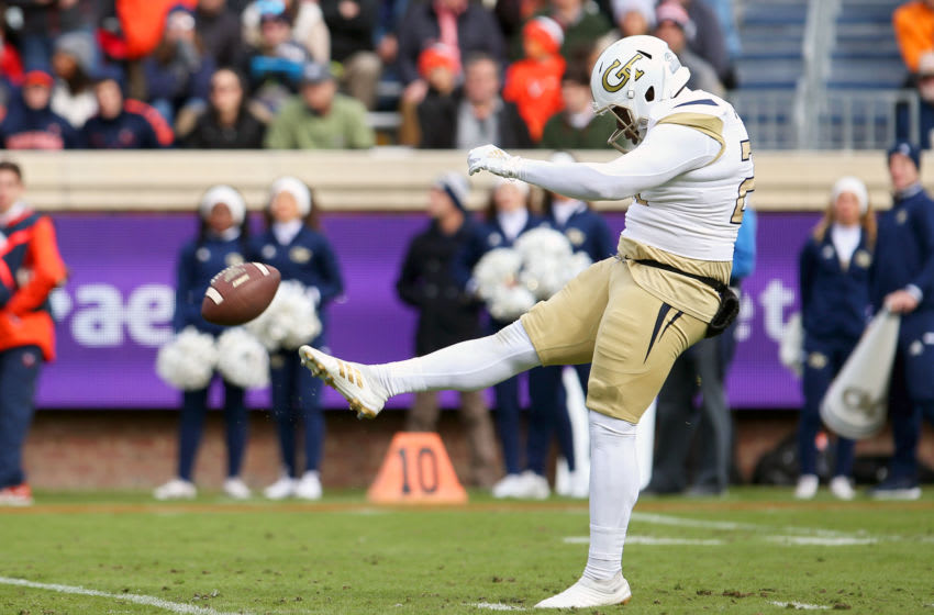 CHARLOTTESVILLE, VA - NOVEMBER 09: Pressley Harvin III #27 of the Georgia Tech Yellow Jackets punts in the first half during a game against the Virginia Cavaliers at Scott Stadium on November 9, 2019 in Charlottesville, Virginia. (Photo by Ryan M. Kelly/Getty Images)