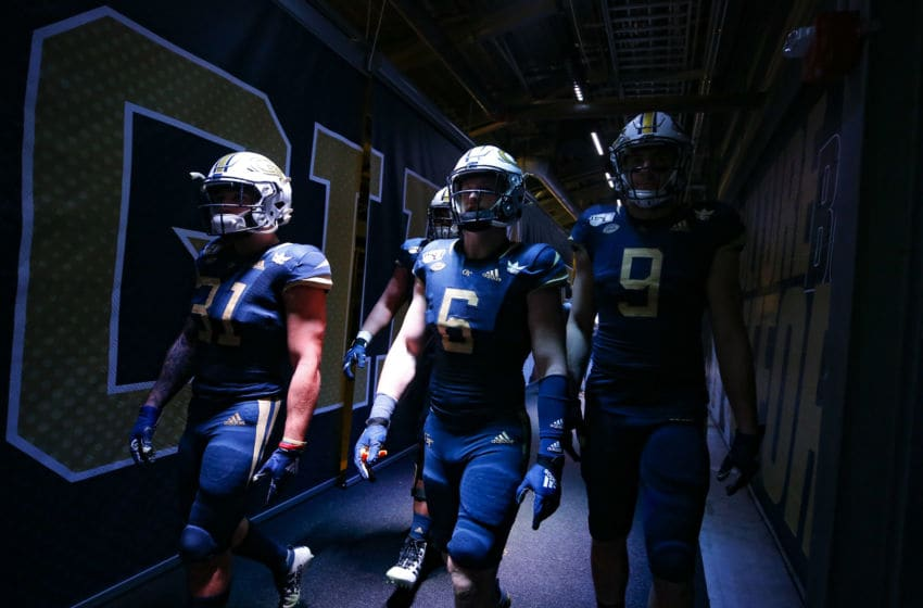 ATLANTA, GA - NOVEMBER 21: Nathan Cottrell #31, David Curry #6 and Tyler Davis #9 of the Georgia Tech Yellow Jackets walk to the field prior to the game against the North Carolina State Wolfpack at Bobby Dodd Stadium on November 21, 2019 in Atlanta, Georgia. (Photo by Todd Kirkland/Getty Images)