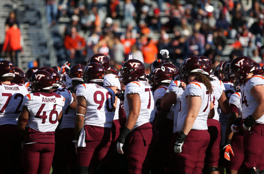 CHARLOTTESVILLE, VA - NOVEMBER 29: The Virginia Tech Hokies warm up before the start of a game against the Virginia Cavaliers at Scott Stadium on November 29, 2019 in Charlottesville, Virginia. (Photo by Ryan M. Kelly/Getty Images)