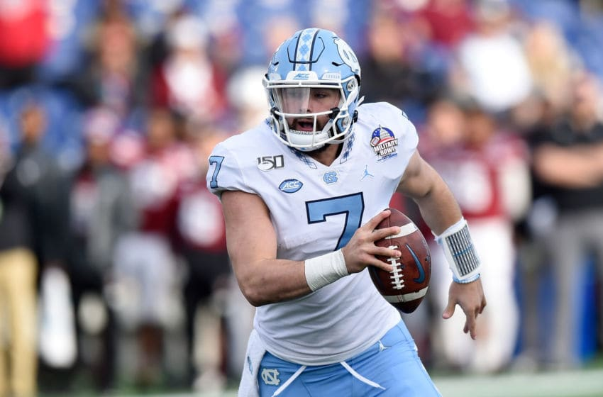 ANNAPOLIS, MD - DECEMBER 27: Sam Howell #7 of the North Carolina Tar Heels rushes the ball against the Temple Owls in the Military Bowl Presented by Northrop Grumman at Navy-Marine Corps Memorial Stadium on December 27, 2019 in Annapolis, Maryland. (Photo by G Fiume/Getty Images)