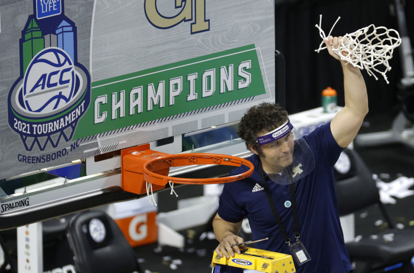 GREENSBORO, NORTH CAROLINA - MARCH 13: Head coach Josh Pastner of the Georgia Tech Yellow Jackets cuts the net from the rim after defeating the Florida State Seminoles in the ACC Men's Basketball Tournament championship game at Greensboro Coliseum on March 13, 2021 in Greensboro, North Carolina. (Photo by Jared C. Tilton/Getty Images)