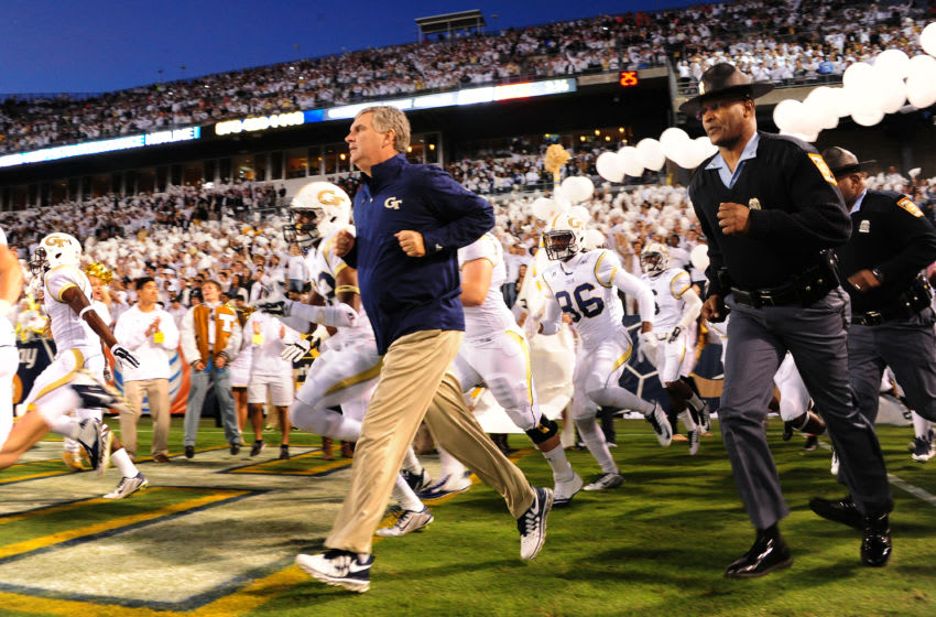 ATLANTA, GA - OCTOBER 4: Head Coach Paul Johnson of the Georgia Tech Yellow Jackets leads his team on to the field before the game against the Miami Hurricanes at Bobby Dodd Stadium on October 4, 2014 in Atlanta, Georgia. (Photo by Scott Cunningham/Getty Images)