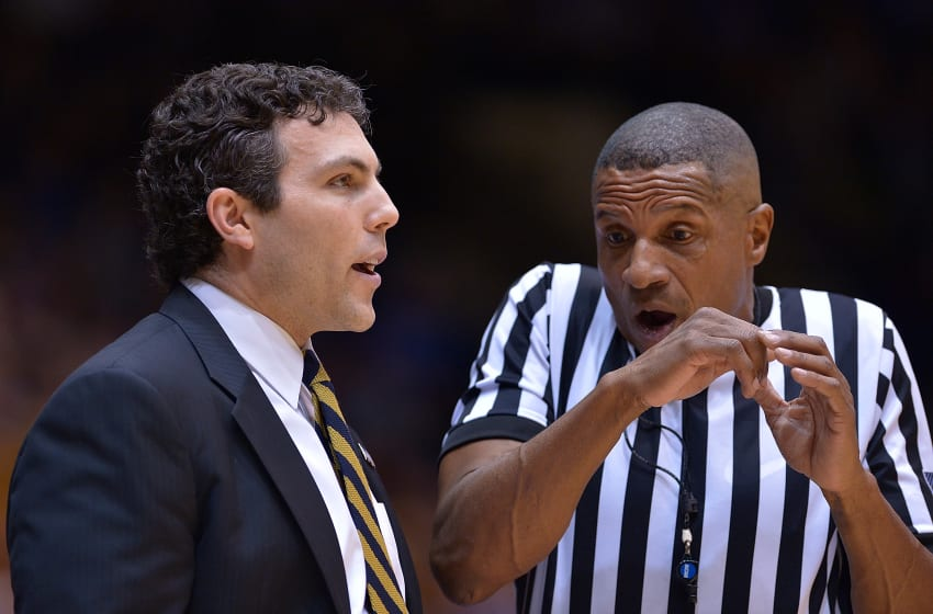 DURHAM, NC - JANUARY 04: Head coach Josh Pastner of the Georgia Tech Yellow Jackets talks with official Ted Valentine during the game against the Duke Blue Devils at Cameron Indoor Stadium on January 4, 2017 in Durham, North Carolina. (Photo by Grant Halverson/Getty Images)