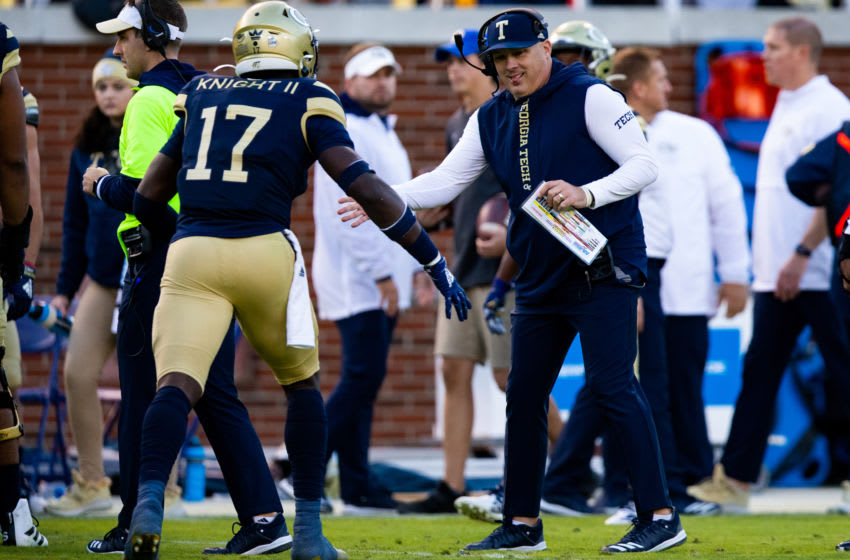 Georgia Tech Head coach Geoff Collins celebrates with Demetrius Knight II (No. 17) during a game against the Pittsburgh Panthers at Bobby Dodd Stadium on November 2, 2019 in Atlanta, Georgia. (Photo by Carmen Mandato/Getty Images)
