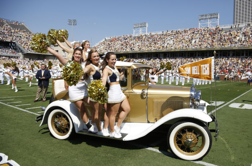 Georgia Tech Yellow Jackets cheerleaders ride out on the Rambling Wreck restored 1930 Model A Ford Sport Coupe car before the game against the Miami Hurricanes at Bobby Dodd Stadium on September 22, 2012 in Atlanta, Georgia. Miami won 42-36 in overtime. (Photo by Joe Robbins/Getty Images)