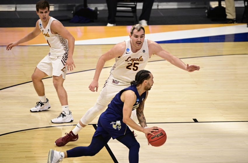 Mar 19, 2021; Indianapolis, Indiana, USA; Georgia Tech Yellow Jackets forward Moses Wright (5) drives against Loyola Ramblers center Cameron Krutwig (25) during the first round of the 2021 NCAA Tournament at Hinkle Fieldhouse. Mandatory Credit: Marc Lebryk-USA TODAY Sports