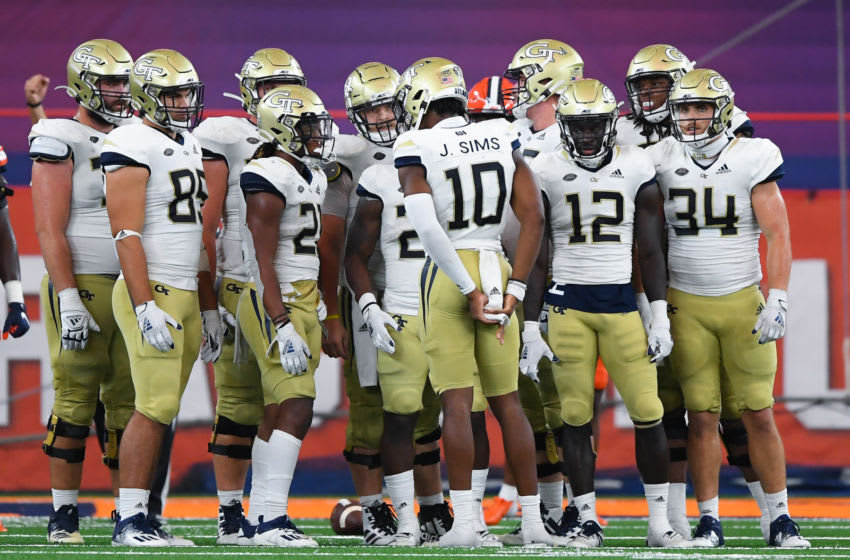Sep 26, 2020; Syracuse, New York, USA; Georgia Tech Yellow Jackets quarterback Jeff Sims (10) calls a play in the huddle against the Syracuse Orange during the third quarter at the Carrier Dome. Mandatory Credit: Rich Barnes-USA TODAY Sports
