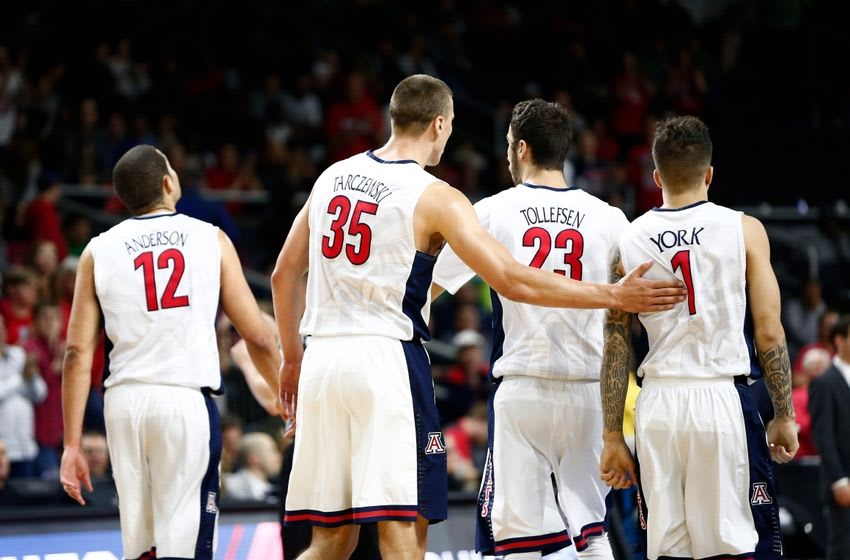 Mar 17, 2016; Providence, RI, USA; Arizona Wildcats forward Ryan Anderson (12) and center Kaleb Tarczewski (35) forward Mark Tollefsen (23) and guard Gabe York (1) walk off of the court during the second half of a first round game against the Wichita State Shockers in the 2016 NCAA Tournament at Dunkin Donuts Center. Mandatory Credit: Mark L. Baer-USA TODAY Sports