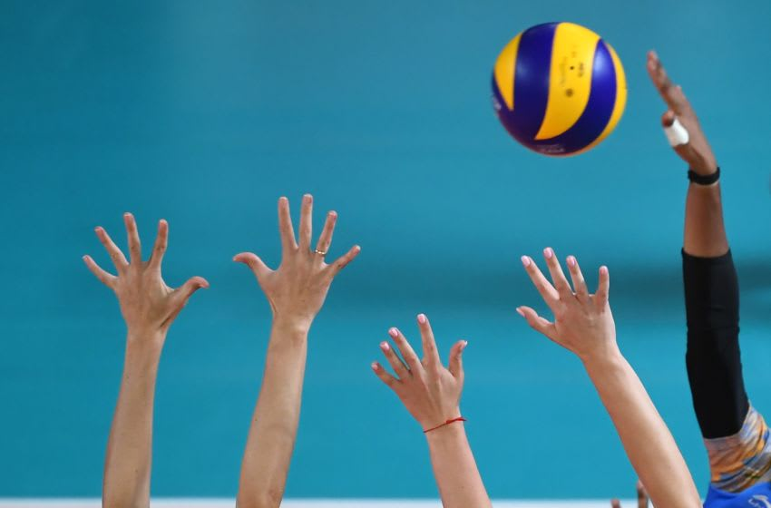 Kazakhstan's players (front) defend the net against India during the women's group B preliminary volleyball match between India and Kazakhstan at the 2018 Asian Games in Jakarta on August 23, 2018. (Photo by PUNIT PARANJPE / AFP) (Photo credit should read PUNIT PARANJPE/AFP via Getty Images)