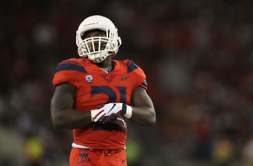 TUCSON, AZ - SEPTEMBER 01: Running back J.J. Taylor #21 of the Arizona Wildcats during the college football game against the Brigham Young Cougars at Arizona Stadium on September 1, 2018 in Tucson, Arizona. The Cougars defeated the Wildcats 28-23. (Photo by Christian Petersen/Getty Images)